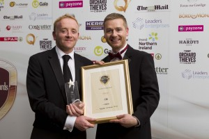 Mark Morgan, ShelfLife, presenting Seamus McHugh, CBE, with the award