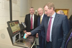 An Taoiseach Enda Kenny using the CBE & NCR Self-Checkout Solution. Also in the picture are Gerard Concannon, CEO; Barry Egan, Enterprise Ireland.  Photo: Joe Travers.
